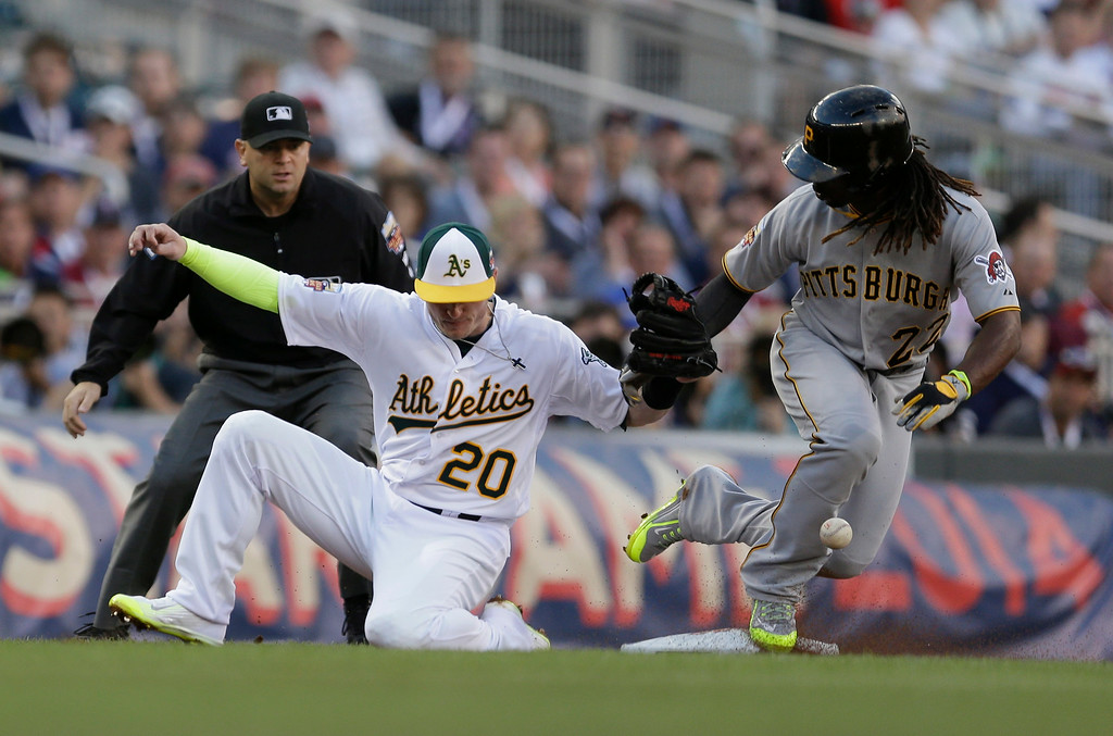. National League outfielder Andrew McCutchen, of the Pittsburgh Pirates, steals third base as American League Josh Donaldson, of the Oakland Athletics, tries to make the tag during the first inning of the MLB All-Star baseball game, Tuesday, July 15, 2014, in Minneapolis. (AP Photo/Jeff Roberson)