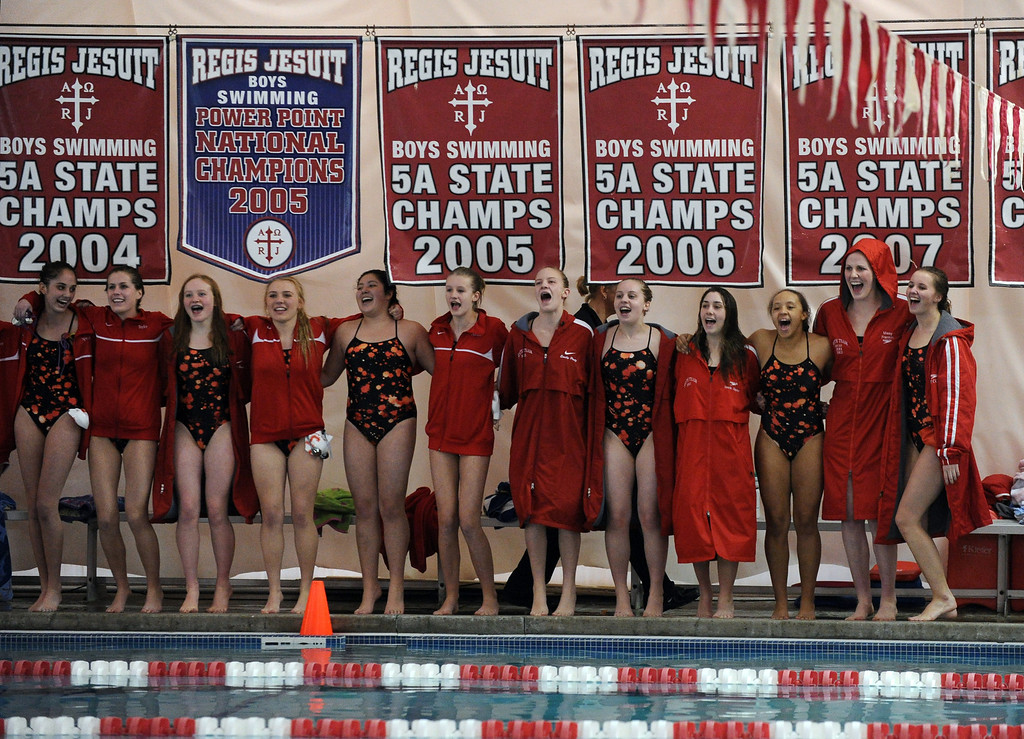 . Olympic gold medalist Missy Franklin of Regis Jesuit, second from right, and swimmers are in the swimming meet against Highlands Ranch at Regis Jesuit swimming pool on Tuesday. Aurora. CO, January 8, 2013.  Hyoung Chang, The Denver Post