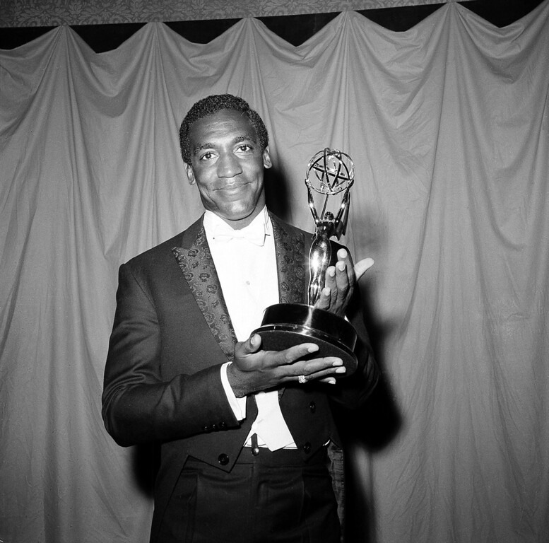 ". Actor and comedian Bill Cosby poses with his Emmy statuette at the annual Primetime Emmy Awards in New York City, May 22, 1966.  The 28-year-old won for his role in ""I Spy\"" and became the first black actor to win an Emmy for a leading role in a television series.  (AP Photo)"