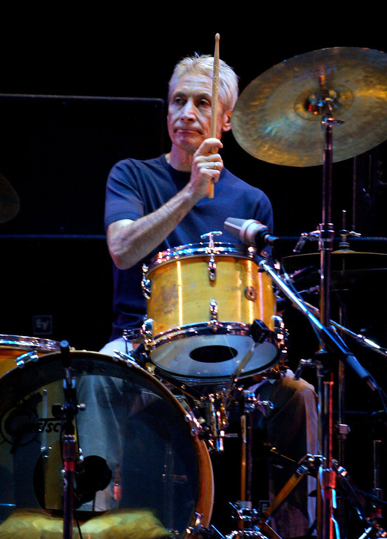 . Rolling Stones drummer, and original band member Charlie Watts performs during the opening night of the Stones U.S. tour in Boston, Mass. Tuesday, Sept. 3, 2002. (AP Photo/Winslow Townson)