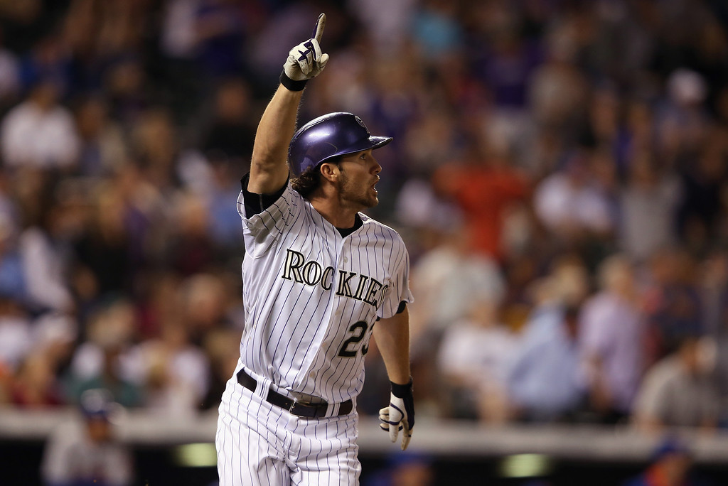 . DENVER, CO - MAY 03:  Charlie Culberson #23 of the Colorado Rockies celebrates his game winning walk off two run pinch hit home run off of Kyle Farnsworth #44 of the New York Mets at Coors Field on May 3, 2014 in Denver, Colorado. The Rockies defeated the Mets 11-10.  (Photo by Doug Pensinger/Getty Images)
