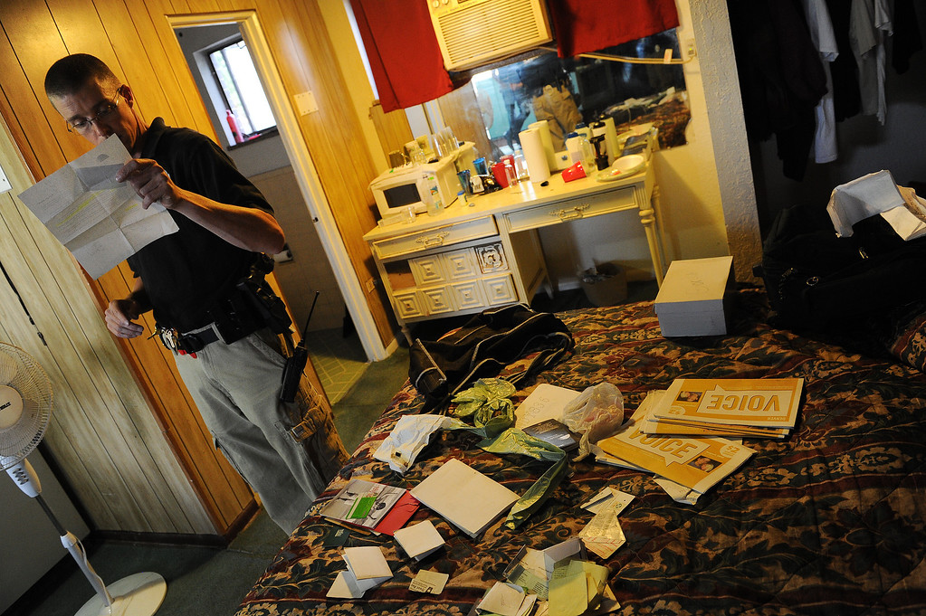 . ENGLEWOOD, CO - AUGUST 7:    Parole Officer Ryan Burch looks at paperwork inside the room of a parolee while doing a search of his room at the Riviera Motel in Aurora, CO on August 7, 2013.  The parolee was arrested for violating parole when the officers found drug paraphernalia on his person.   Any kind of parole violations such as drugs, drug paraphernalia, pornography etc. are considered a violation of parole. The visits are unscheduled and the parolees never know when a parole officer is going to stop by their place of residence.  The officer is allowed to completely search their apartment looking for any parole violations.  The Riviera Motel is a place where many parolees go when they get out on parole.  They are given two weeks worth of vouchers to stay at hotels such as these along Colfax Ave.  (Photo by Helen H. Richardson/The Denver Post)