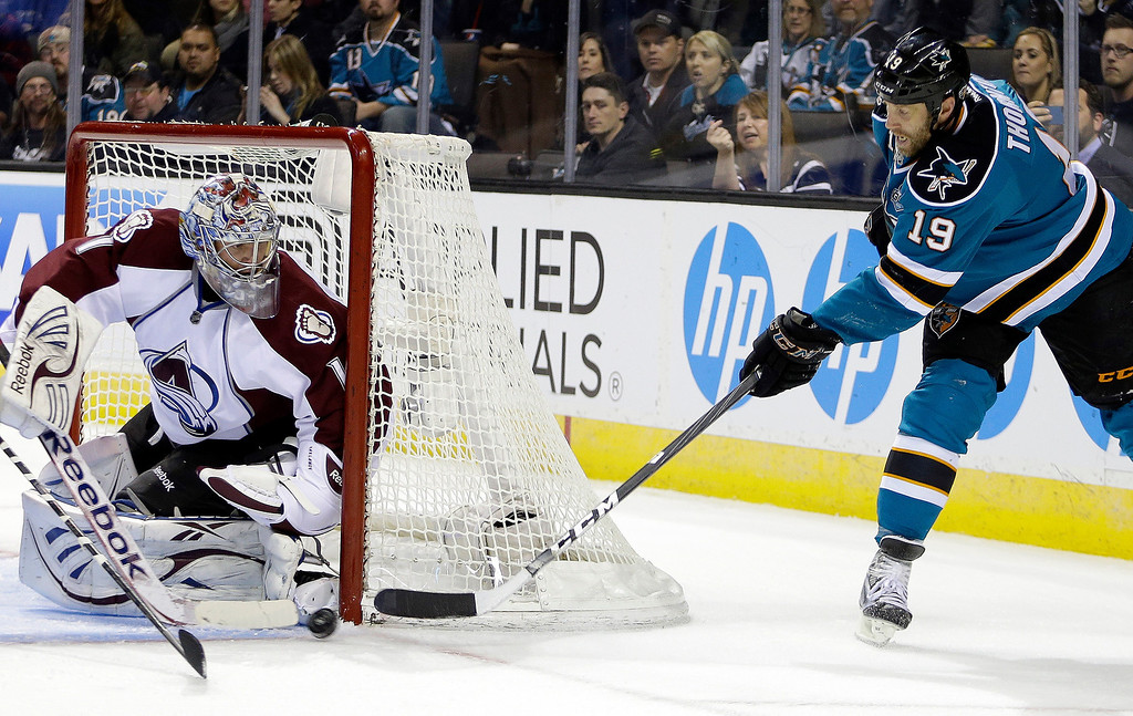 . Colorado Avalanche goalie Semyon Varlamov, left, blocks a shot from San Jose Sharks\' Joe Thornton (19) during the first period of an NHL hockey game Tuesday, February 26, 2013, in San Jose, Calif. (AP Photo/Ben Margot)