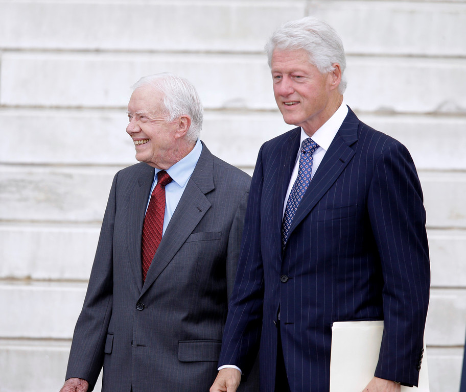 """. Former Presidents Jimmy Carter and Bill Clinton arrive at the Let Freedom Ring ceremony at the Lincoln Memorial in Washington, Wednesday, Aug. 28, 2013,  to commemorate the 50th anniversary of the 1963 March on Washington for Jobs and Freedom. It was 50 years ago today when Martin Luther King Jr. delivered his \""""I Have a Dream\"""" speech from the steps of the memorial.   (AP Photo/Carolyn Kaster)"""