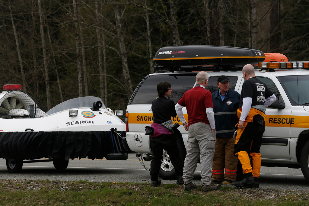. Search and Rescue personnel gather near the site of a fatal mudslide near Oso, Wash., Saturday, March 22, 2014. (AP Photo /The Daily Herald, Annie Mulligan)