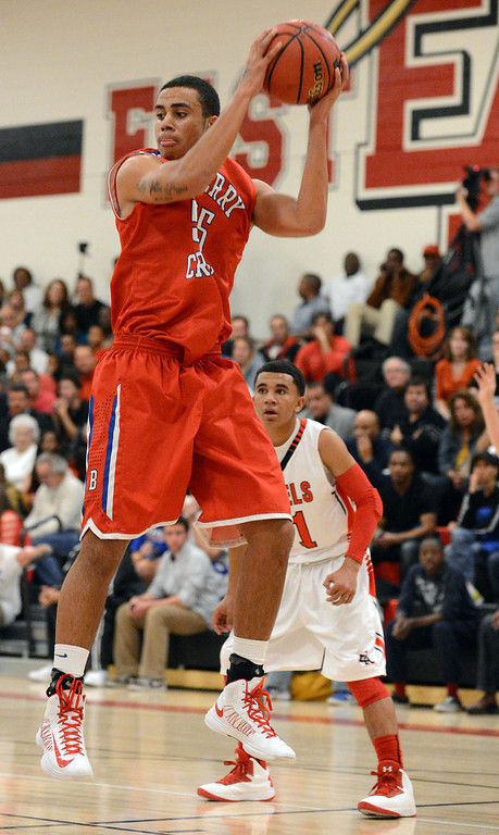 . Cherry Creek\'s Quentin Welu, left, rebounds the ball by East\'s Brian Carey in the 1st half of the game at East High School on Friday, Nov. 30, 2012. Hyoung Chang, The Denver Post