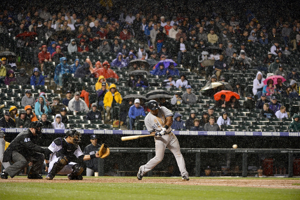 . DENVER, CO. - MAY 07: Chris Nelson (39) of the New York Yankees battles the rain in the fifth inning in their game against the Colorado Rockies May 7, 2013 at Coors Field. (Photo By John Leyba/The Denver Post)