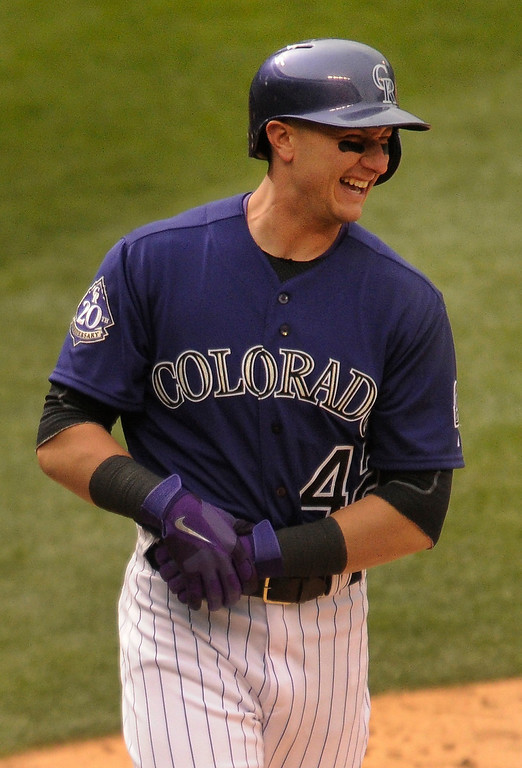 . Rockies batter Troy Tulowitzki grabbed his wrist after being hit by a pitch in the fifth inning. The Colorado Rockies hosted the New York Mets in a make up game Tuesday afternoon, April 16, 2013. Monday night\'s game was snowed out at Coors Field.  Photo By Karl Gehring/The Denver Post)