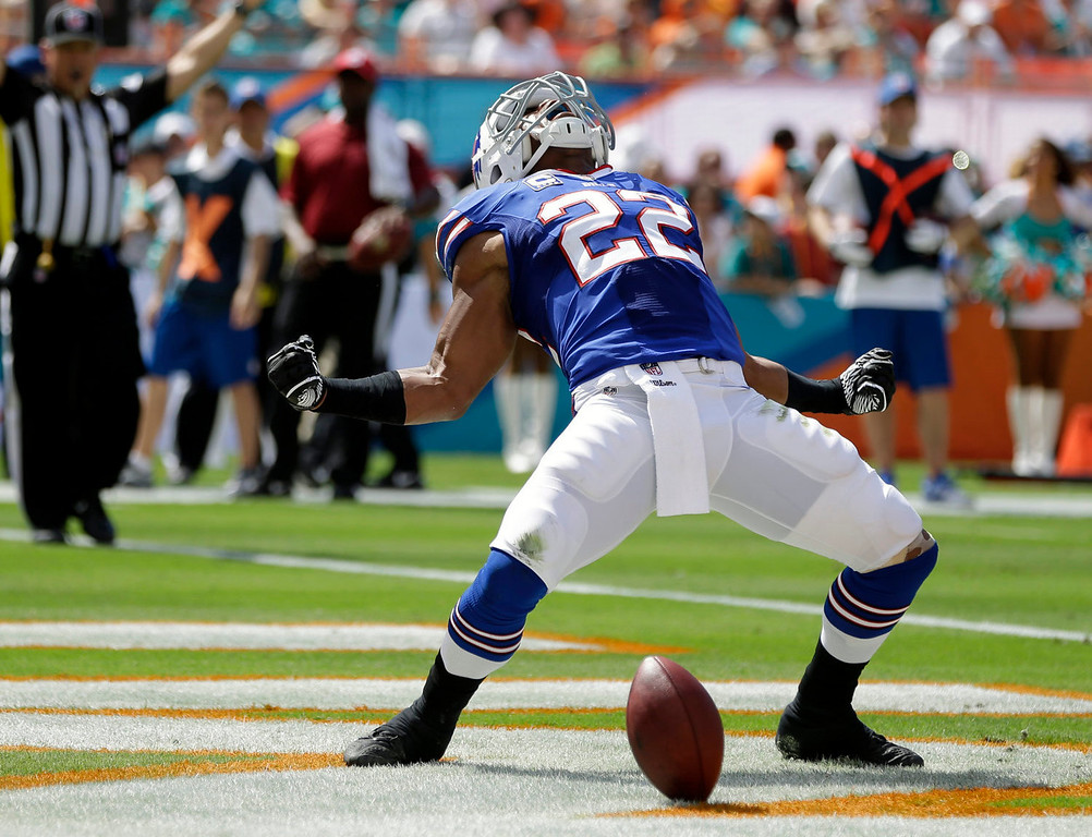 . Buffalo Bills running back Fred Jackson (22) celebrates a touchdown during the first half of an NFL football game against the Miami Dolphins, Sunday, Oct. 20, 2013, in Miami Gardens, Fla. (AP Photo/Lynne Sladky)