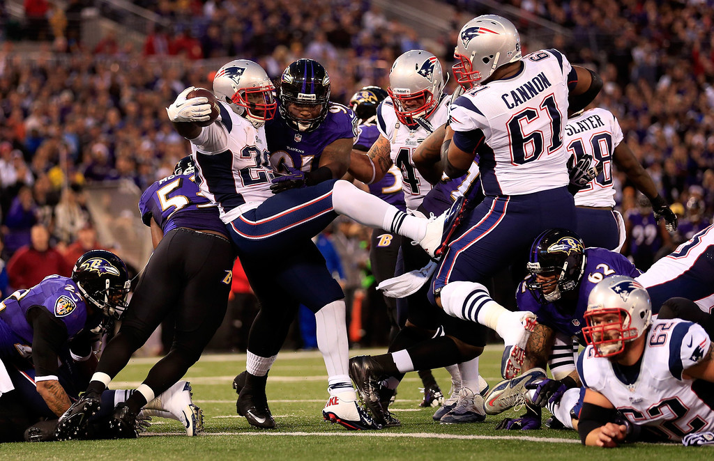 . Running back LeGarrette Blount #29 of the New England Patriots bounces off of outside linebacker Courtney Upshaw #91 of the Baltimore Ravens to score a touchdown in the first half at M&T Bank Stadium on December 22, 2013 in Baltimore, Maryland.  (Photo by Rob Carr/Getty Images)