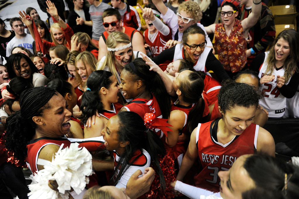. BOULDER, CO. - MARCH 16: The Raiders celebrated with fans Saturday. The Regis Jesuit High School girl\'s basketball team defeated Highlands Ranch 53-46 in the 5A championship game Saturday, March 16, 2013 at the Coors Events Center in Boulder.  (Photo By Karl Gehring/The Denver Post)