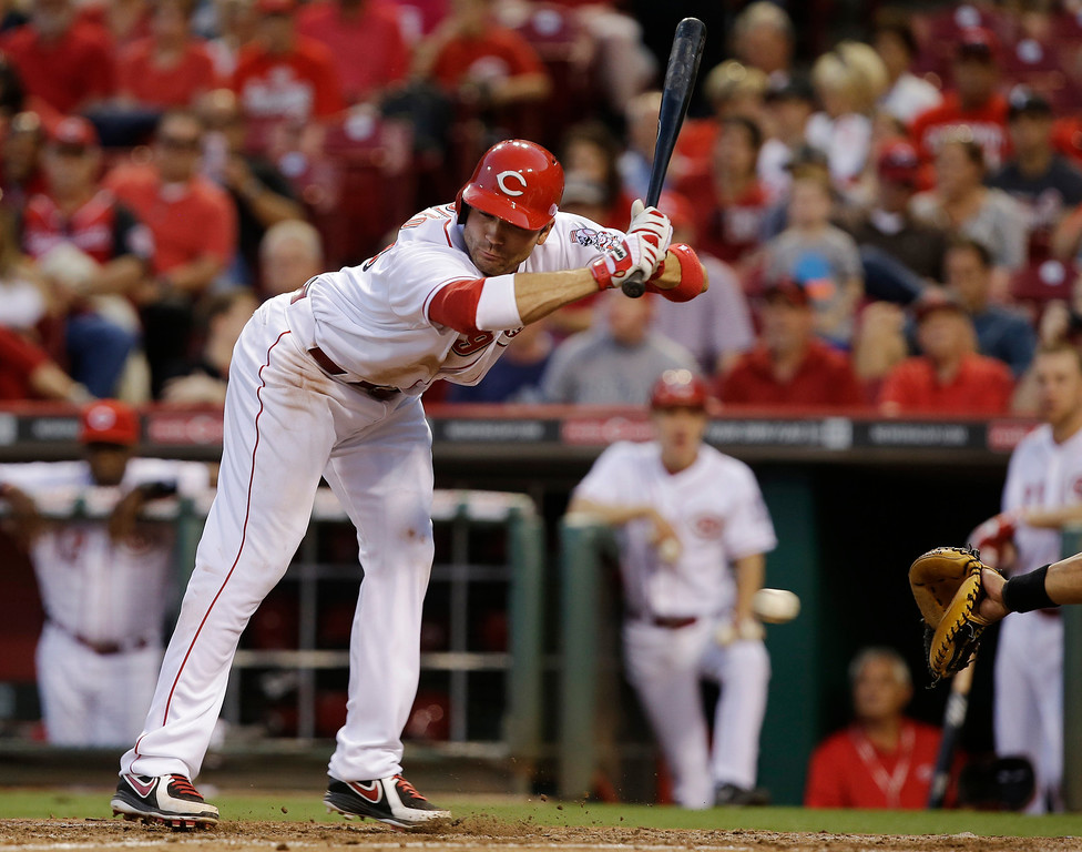 . Cincinnati Reds\' Joey Votto is backed off the plate by an inside pitch from Colorado Rockies starting pitcher Juan Nicasio in the fifth inning of a baseball game, Tuesday, June 4, 2013, in Cincinnati. (AP Photo/Al Behrman)