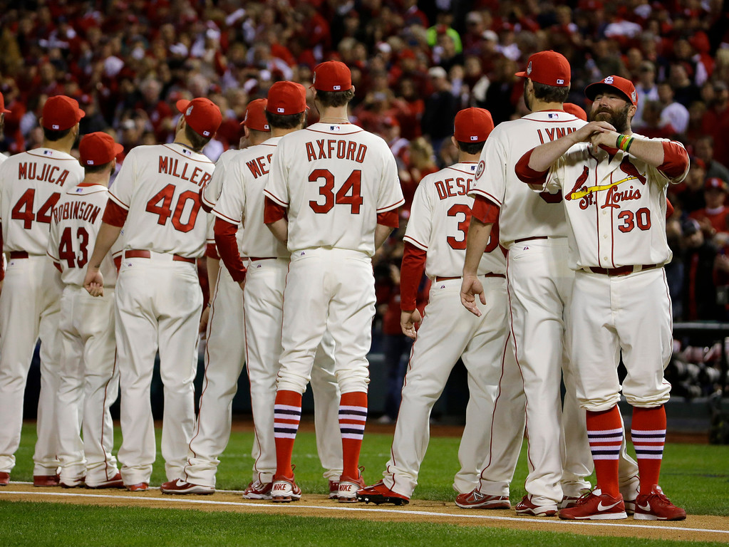 . St. Louis Cardinals\' Jason Motte pulls on his beard during introductions before Game 3 of baseball\'s World Series against the Boston Red Sox Saturday, Oct. 26, 2013, in St. Louis. (AP Photo/Matt Slocum)