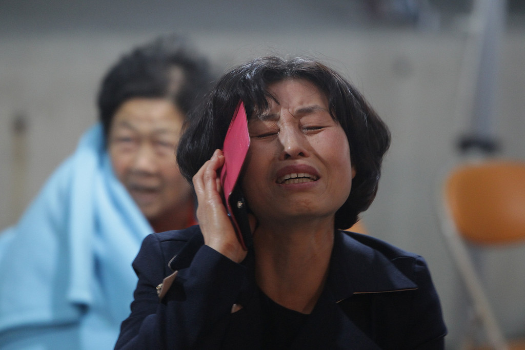 . A Woman cries at Jindo port on April 16, 2014 in Jindo-gun, South Korea. Two people are dead, and more than ninety are missing as reported. The ferry identified as the Sewol was carrying about 470 passengers, including the students and teachers, traveling to Jeju island.  (Photo by Chung Sung-Jun/Getty Images)