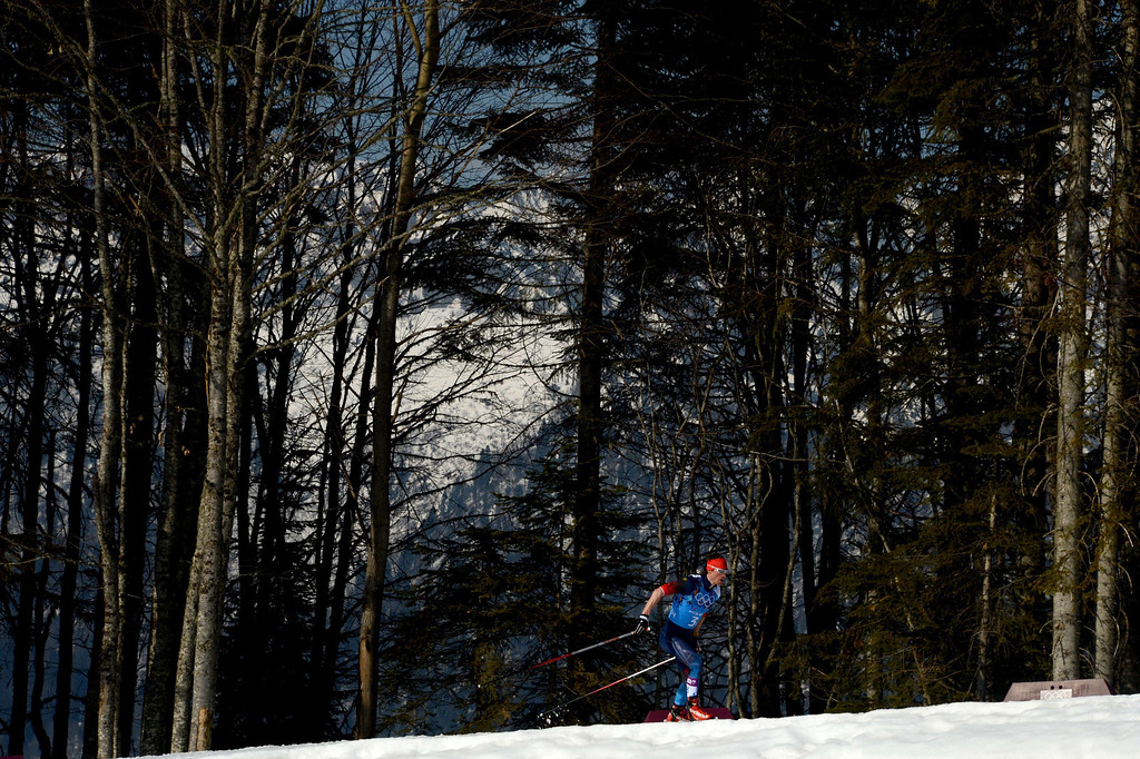 . Russia\'s Maxim Vylegzhanin competes in the Men\'s Cross-Country Skiing 4 x 10km Relay at the Laura Cross-Country Ski and Biathlon Center during the Sochi Winter Olympics on February 16, 2014 in Rosa Khutor near Sochi. KIRILL KUDRYAVTSEV/AFP/Getty Images