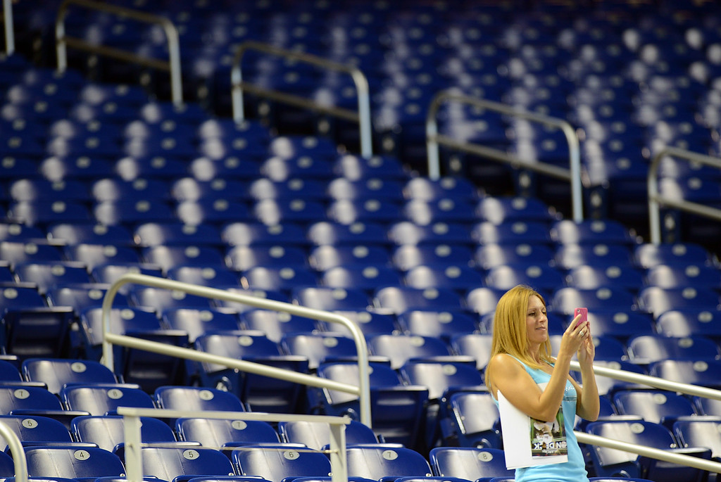 . MIAMI, FL - AUGUST 24: A fan takes a photo in empty stands as the Miami Marlins play against the Colorado Rockies  at Marlins Park on August 24, 2013 in Miami, Florida.  (Photo by Jason Arnold/Getty Images)