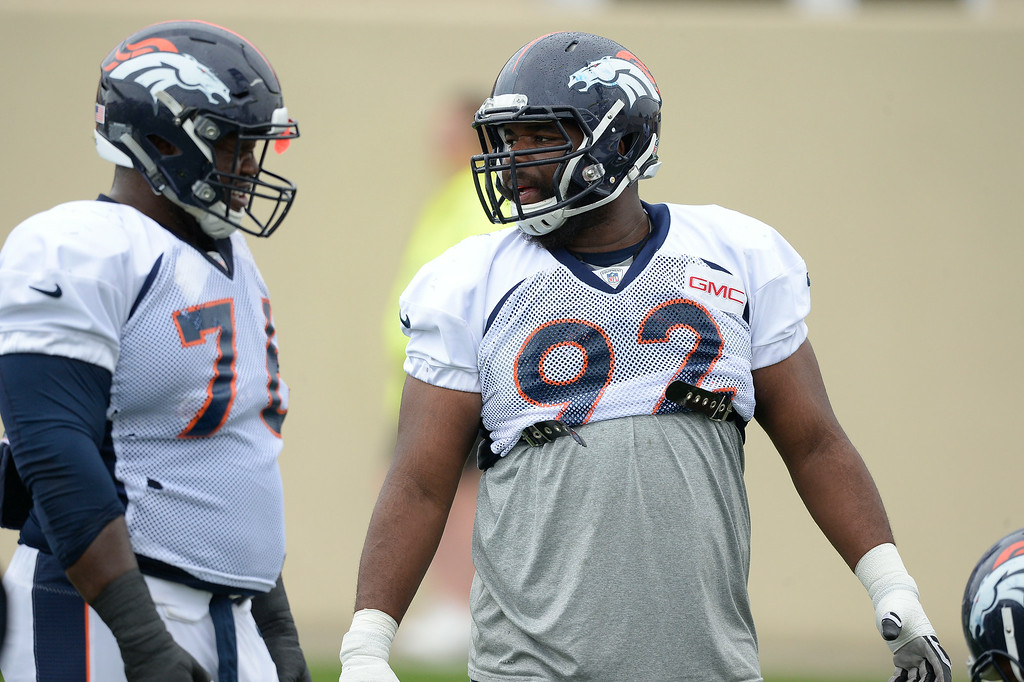 . Denver Broncos defensive tackle Marvin Austin (76) and Denver Broncos defensive tackle Sylvester Williams (92) look on during drills on day seven of the Denver Broncos 2014 training camp July 31, 2014 at Dove Valley. (Photo by John Leyba/The Denver Post)