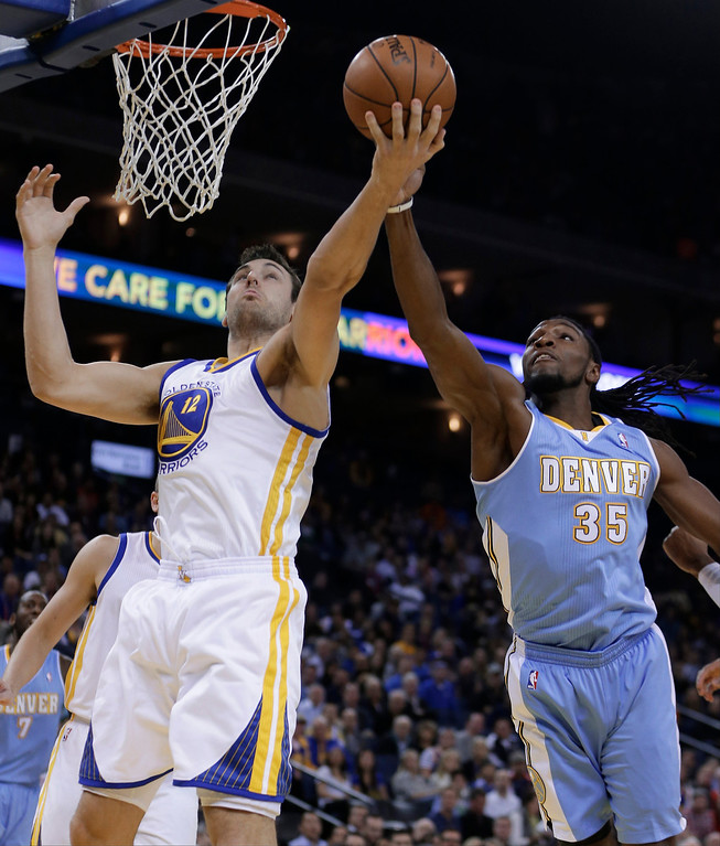 . Denver Nuggets\' Kenneth Faried, right, and Golden State Warriors\' Andrew Bogut (12) reach for a rebound during the first half of an NBA basketball game on Wednesday, Jan. 15, 2014, in Oakland, Calif. (AP Photo/Ben Margot)