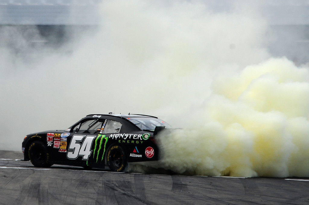 . LOUDON, NH - JULY 13:  Kyle Busch, driver of the #54 Monster Energy Toyota, celebrates winning the NASCAR Nationwide Series CNBC Prime\'s The Profit 200 at New Hampshire Motor Speedway on July 13, 2013 in Loudon, New Hampshire.  (Photo by Jared C. Tilton/Getty Images)