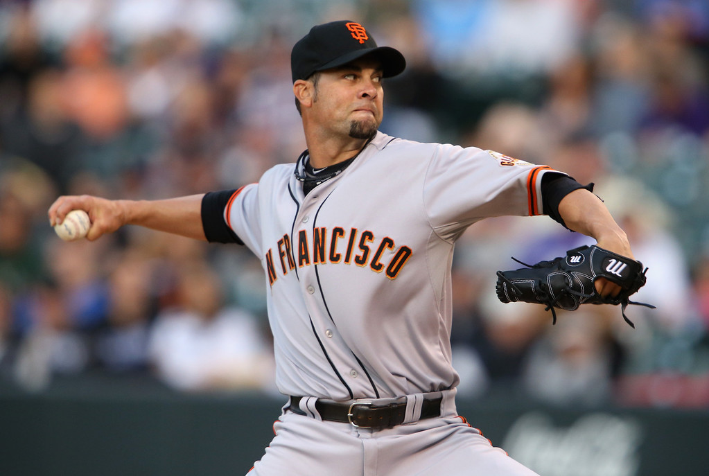 . Starting pitcher Ryan Vogelsong #32 of the San Francisco Giants delivers against the Colorado Rockies at Coors Field on April 21, 2014 in Denver, Colorado.  (Photo by Doug Pensinger/Getty Images)