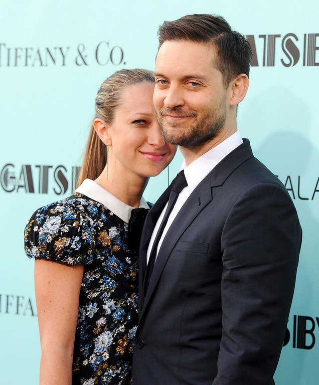 ". Actor Tobey Maguire, right, and wife Jennifer Meyer attend ""The Great Gatsby\"" world premiere at Avery Fisher Hall on Wednesday, May 1, 2013, in New York. (Photo by Evan Agostini/Invision/AP)"
