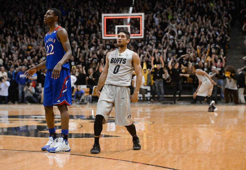 . Colorado University guard, Askia Booker, right, watches and hits a three-pointer on the last shot of the game to win against Andrew Wiggins and the Kansas Jayhawks 75-72 at the Coors Events Center in Boulder Colorado Saturday afternoon, December 07, 2013.  (Photo By Andy Cross/The Denver Post)