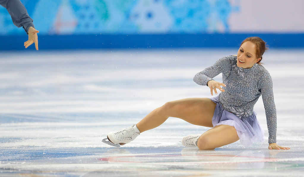 Description of . Maylin Wende falls as she and Daniel Wende of Germany compete in the pairs short program figure skating competition at the Iceberg Skating Palace during the 2014 Winter Olympics, Tuesday, Feb. 11, 2014, in Sochi, Russia. (AP Photo/Vadim Ghirda)