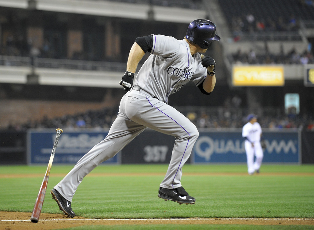 . SAN DIEGO, CA - APRIL 16:  Justin Morneau #33 of the Colorado Rockies hits a double during the fourth inning of a  baseball game against the San Diego Padres at Petco Park April 16, 2014 in San Diego, California.  (Photo by Denis Poroy/Getty Images)