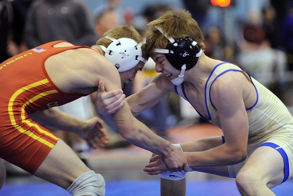 . Trent Watson of Coronado, left, and Darek Huff of Broomfield are in action during the 106 pound final of Northern Colorado Christmas Tournament at Island Grove Event Center in Greeley, Colo., on Saturday, Dec. 22, 2012. Watson won the match. Hyoung Chang, The Denver Post