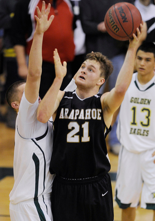 . Arapahoe post Mitch Albyn (21) put up a shot in the second half. The Mountain Vista High School boy\'s basketball team defeated Arapahoe 69-54 Friday night January 4, 2013.  Karl Gehring/The Denver Post