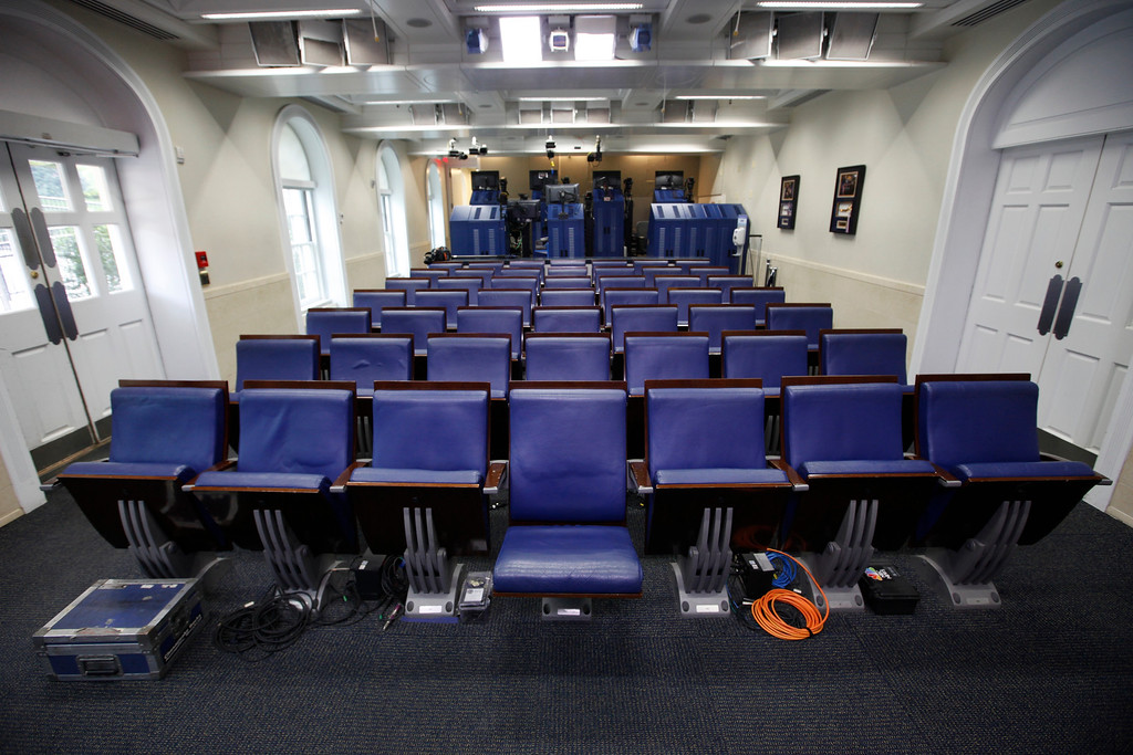 . The seat of former White House correspondent Helen Thomas, front row center, is seen in the James Brady Press Briefing Room in the West Wing of the White House in Washington, Saturday, July 31, 2010. (AP Photo/Charles Dharapak)