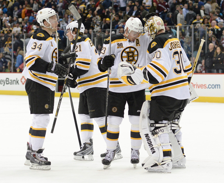 . Teammates congratulated Bruins goalie Chad Johnson on his shutout Friday night. The Boston Bruins blanked the Colorado Avalanche 2-0 at the Pepsi Center Friday night, March 21, 2014. (Photo by Karl Gehring/The Denver Post)