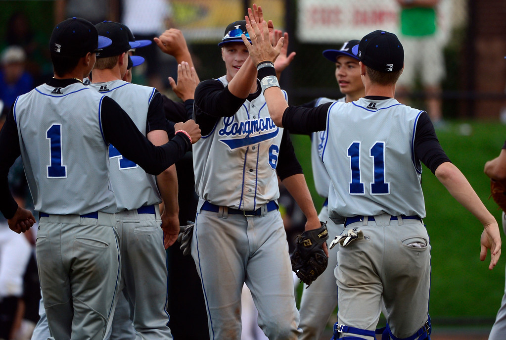 . LAKEWOOD, CO - MAY 23: Longmont celebrates its win including grand-slam home-run hitter Andrew Baldt (6). The Longmont Trojans take on the Niwot Cougars in the 4A Baseball State Semi-Final Championships. (Kathryn Scott Osler, The Denver Post)