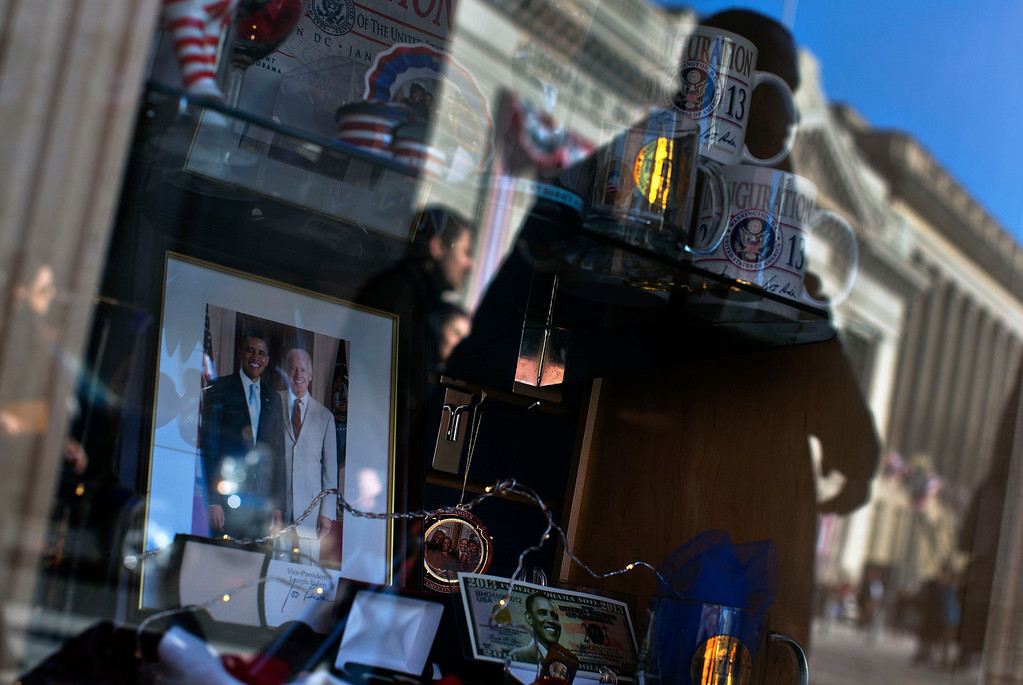 . Political souvenirs are seen inside a store window along the U.S. presidential parade route in Washington January 20, 2013. President Barack Obama took the official oath for his second term on Sunday at the White House in a small, private ceremony that set a more subdued tone compared to the historic start of his presidency four years ago. REUTERS/Shannon Stapleton