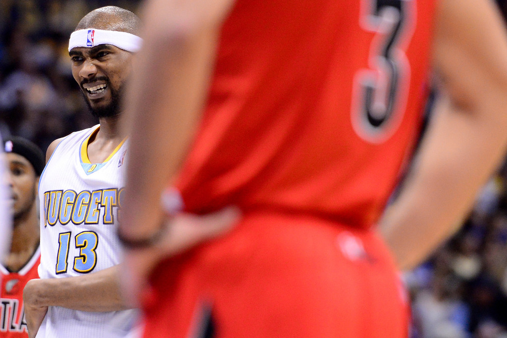 . DENVER, CO - APRIL 14: Corey Brewer (13) of the Denver Nuggets grabs his hip after being fouled during the first half of action. The Denver Nuggets play the Portland Trail Blazers at the Pepsi Center. (Photo by AAron Ontiveroz/The Denver Post)