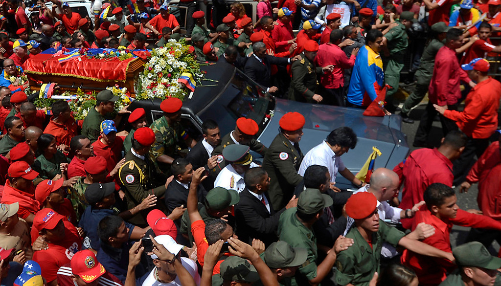 . Venezuelan acting President Nicolas Maduro (3rd R back) and Bolivian President Evo Morales (C in white) accompany the hearse carrying the coffin of Venezuelan President Hugo Chavez on its way to the Military Academy, on March 6, 2013, in Caracas.   AFP PHOTO/Juan BARRETO/AFP/Getty Images