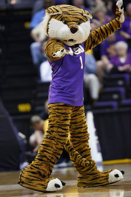 . Mike the LSU tiger mascot strikes a dance move during a timeout during the second half of an NCAA college basketball first-round tournament game against Georgia Tech, Sunday, March 23, 2014, in Baton Rouge, La. LSU won 98-78. (AP Photo/Rogelio V. Solis)