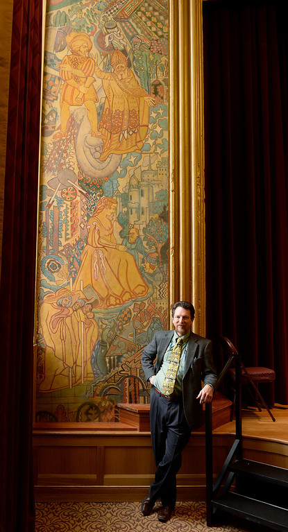 """. Dan Jacobs, curator for the University of Denver collection and director of the school\'s  Victoria H. Myhren Gallery shows off the  newly restored  \""""Shakespeare Mural\"""" by John Thompson in the  Reiman Theater at the Daniels College of Business at the University of Denver campus on Wednesday April 23, 2014. The mural was painted in 1929.  (Denver Post Photo by Cyrus McCrimmon)"""