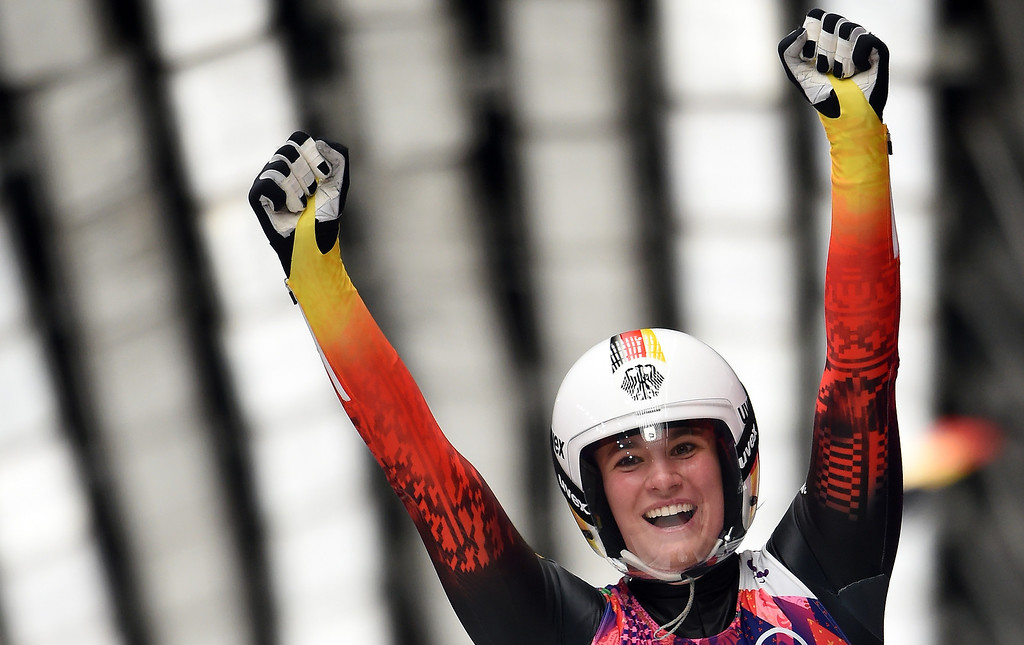 . Germany\'s Natalie Geisenberger celebrates as she wins the Women\'s Luge Singles event final run at the Sanki Sliding Center during the Sochi Winter Olympics on February 11, 2014.      AFP PHOTO / LEON NEALLEON NEAL/AFP/Getty Images