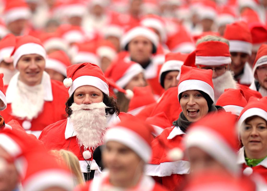 . Participants of the 5th Michendorfer Nikolauslauf (lit. Michendorf Saint Nicholas race) start their 10 kilometer fun run in Michendorf, Germany, Sunday Dec. 8, 2013. . (AP Photo/dpa, Ralf Hirschberger)