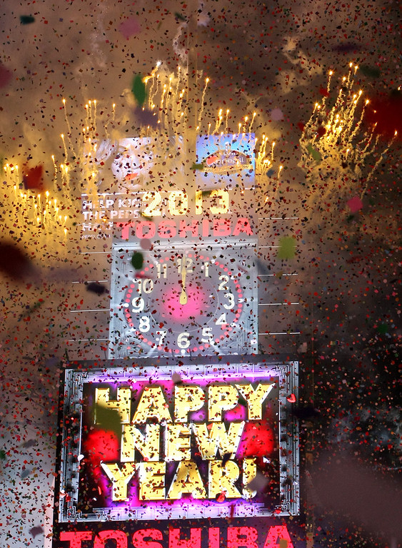. NEW YORK, NY - JANUARY 1: Fireworks explode at the stroke of midnight in Times Square on January 1, 2013 in New York City. Approximately one million people are expected to ring in the new year in Times Square. (Photo by Monika Graff/Getty Images)