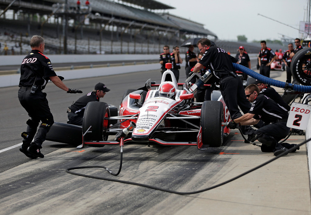 . AJ Allmendinger practices a pit stop with his crew during practice for the Indianapolis 500 auto race at the Indianapolis Motor Speedway in Indianapolis, Wednesday, May 15, 2013. (AP Photo/Darron Cummings)