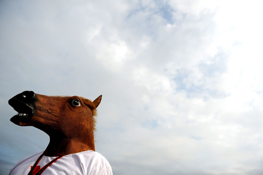 . BALTIMORE, MD - MAY 18:  A fan with a Horse mask on attends the 138th running of the Preakness Stakes at Pimlico Race Course on May 18, 2013 in Baltimore, Maryland.  (Photo by Patrick Smith/Getty Images)