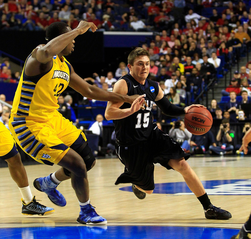 . Butler guard Rotnei Clarke (15) drives against Marquette center Chris Otule (42) in the first half of a third-round NCAA college basketball tournament game on Saturday, March 23, 2013, in Lexington, Ky. (AP Photo/James Crisp)