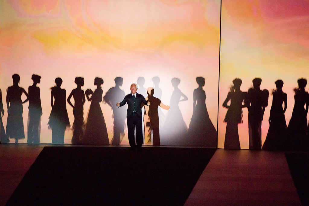 ". Giorgio Armani takes a bow at the conclusion of his ""One Night Only New Yorkî fashion show on Thursday, Oct. 24, 2013 in New York. (Photo by Charles Sykes/Invision/AP)"