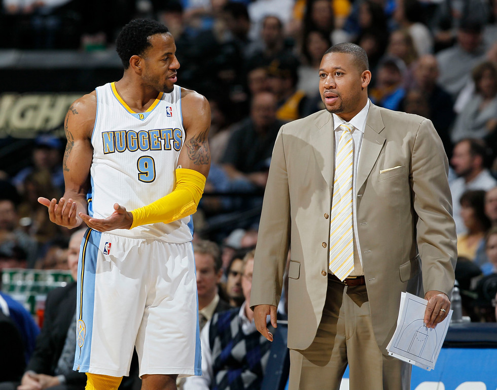 . Denver Nuggets guard Andre Iguodala, left, confers with assistant coach Melvin Hunt during the third quarter of the Nuggets\' 121-93 victory over the Sacramento Kings in an NBA basketball game in Denver on Saturday, Jan. 26, 2013. (AP Photo/David Zalubowski)