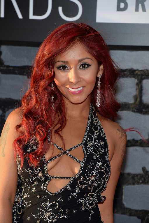 . Television personality Nicole \'Snooki\' Polizzi attends the 2013 MTV Video Music Awards at the Barclays Center on August 25, 2013 in the Brooklyn borough of New York City.  (Photo by Jamie McCarthy/Getty Images for MTV)
