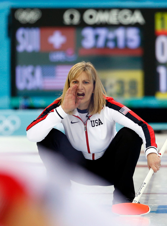 . Team USA\'s skip Erika Brown shouts instructions to her teammates after delivering the rock during women\'s curling competition against Switzerland at the 2014 Winter Olympics, Monday, Feb. 10, 2014, in Sochi, Russia. (AP Photo/Robert F. Bukaty)