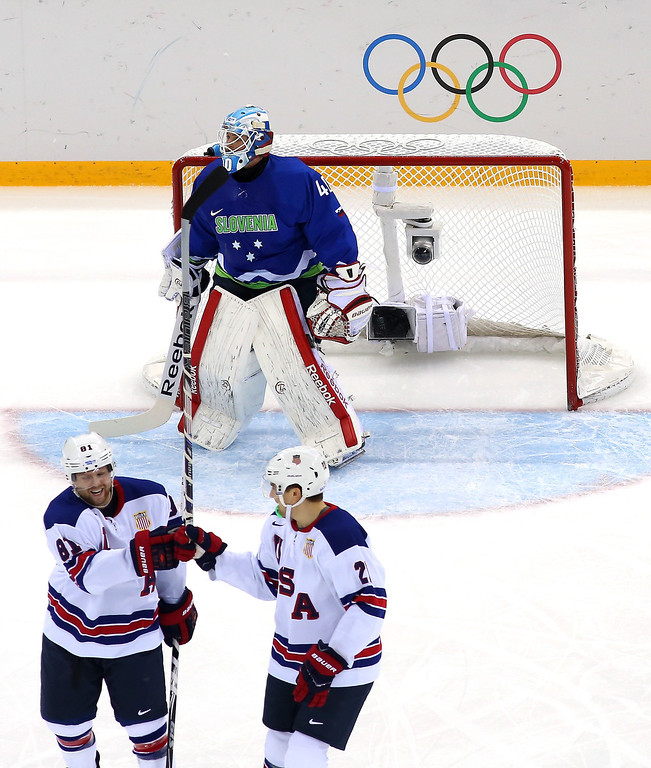 . Phil Kessel #81 of the United States celebrates with James van Riemsdyk #21 after scroing his second goal of the first period against Luka Gracnar #40 of Slovenia during the Men\'s Ice Hockey Preliminary Round Group A game on day nine of the Sochi 2014 Winter Olympics at Shayba Arena on February 16, 2014 in Sochi, Russia.  (Photo by Martin Rose/Getty Images)
