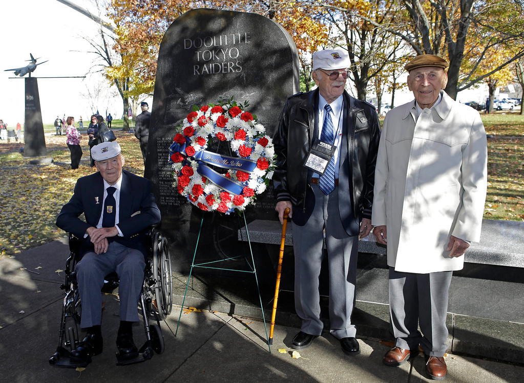 . Three of the four surviving members of the 1942 Tokyo raid led by Lt. Col. Jimmy Doolittle, left to right, David Thatcher, Edward Saylor, and Richard Cole, pose next to a monument marking the raid, Saturday, Nov. 9, 2013, outside the National Museum for the US Air Force in Dayton, Ohio. The fourth surviving member, Robert Hite, was unable to travel to the ceremonies. (AP Photo/Al Behrman)